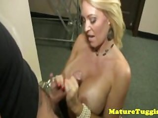 Monsterboobs milf tugging a dick in cool..