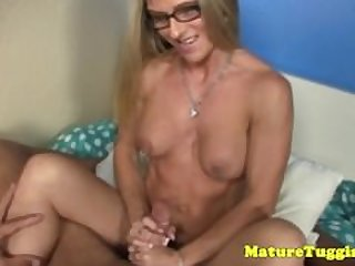 Jerking spex milf with pierced fake tits..
