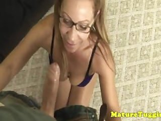 Tugging amateur milf with glasses in..