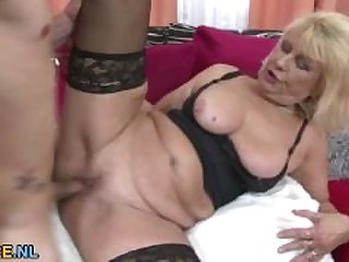 Busty blonde mature riding a cock in..