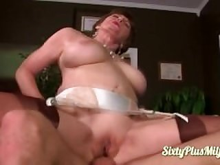 Big tit Sonya rides a young guy