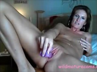 My friends mother masturbates her pussy..