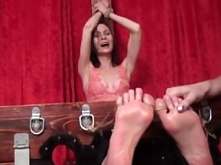 milf kira tickled torture in stocks