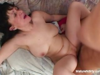 Busty brunette mature gets pounded on..