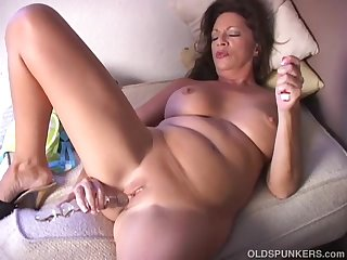 Naughty old spunker plays with her juicy..
