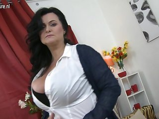 Huge breasted mature lady playing with..