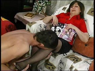 mature in stockings with a young guy