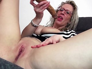 Spectacled mature mom with big tits and..