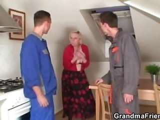 Two repairmen bang busty grandma from..