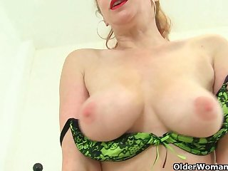 British milf Red strips off and finger..