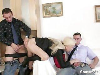She sucks and fucks two cocks at job..
